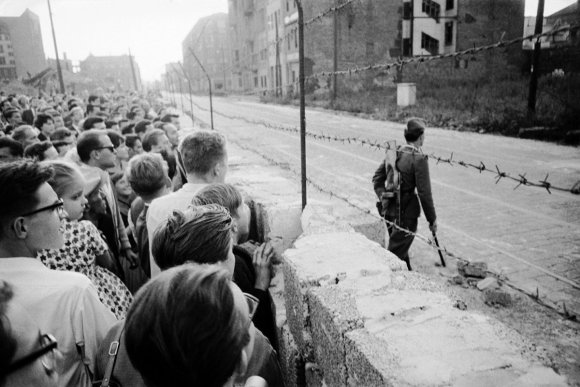 An East German mason builds up a fresh portion of the Berlin Wall in August 1961.
